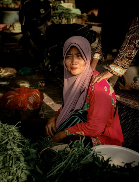 Woman Wearing Pink Hijab In The Market Place Selling Scaled